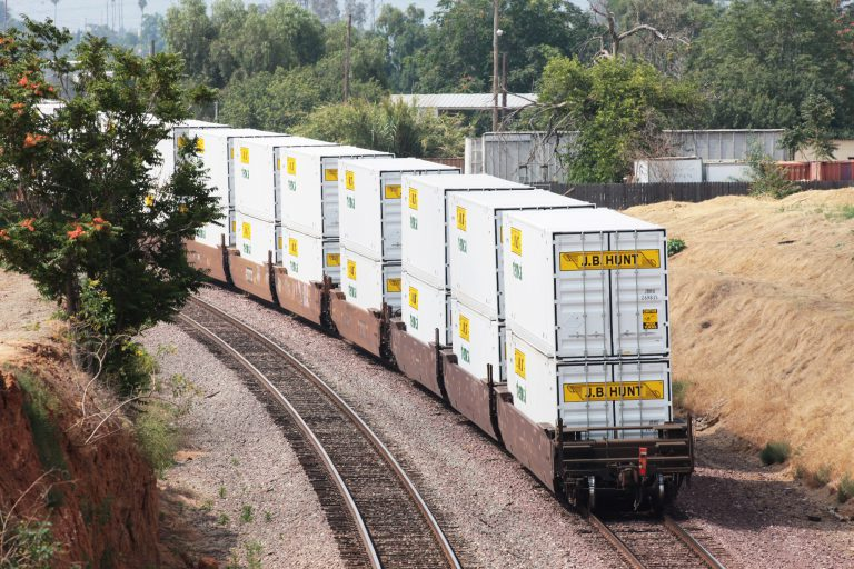 J.B. Hunt Intermodal containers lined up on train tracks.