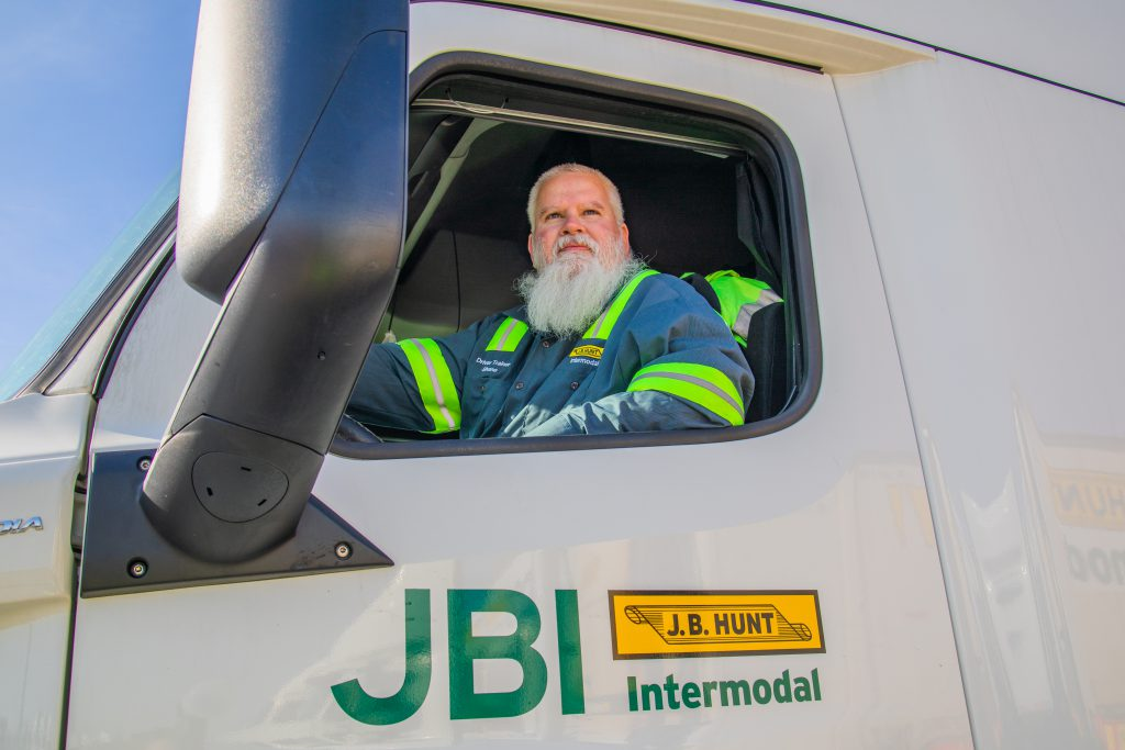 Driver Shane looks out the window of his J.B. Hunt Intermodal truck.